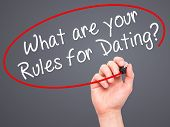 pic of taboo  - Man Hand writing What are your Rules for Dating - JPG