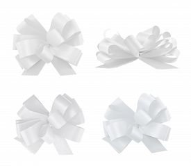 image of four  - Set of four gift white ribbon bows isolated over white background - JPG
