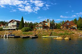 picture of dock a lake  - Modern homes overlooking the lake with their own docks and boats taken in Big Bear Lake - JPG