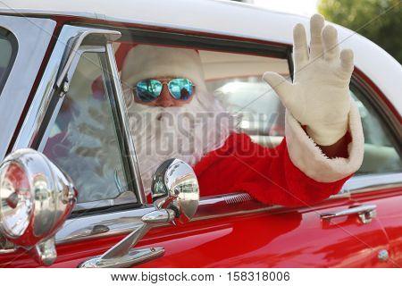 poster of Santa Claus drives his Hot Rod Car. Santa Drives his car. Santa Claus arrives in style. Santa Cruise