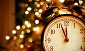Vintage Alarm Clock Is Showing Midnight. It Is Twelve Oclock, Christmas And Bokeh, Holiday Happy Ne poster