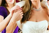 stock photo of bolero  - Bride at the clothes shop for wedding dresses - JPG