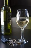 image of car key  - A bottle of wine is near a glass of cold white wine - JPG