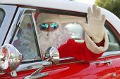 Santa Claus drives his Hot Rod Car. Santa Drives his car. Santa Claus arrives in style. Santa Cruise poster