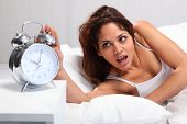 Woman overslept with alarm clock