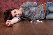 Teenager Overdose On Pills Lying On Floor