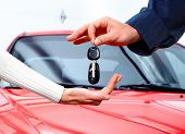 stock photo of car key  - Man handing woman automobile keys - JPG