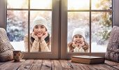 Happy loving family! Mother and child girl having fun, playing and laughing on snowy winter walk in  poster