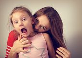 Angry Emotional Young Mother Wanting To Bite Her Naughty Capricious Daughter With Screaming Nervous poster
