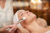 Постер, плакат: people beauty spa cosmetology and skincare concept close up of beautiful young woman lying with