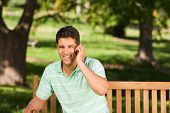 Young handsome man phoning