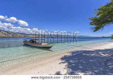 A Boat Docked On A