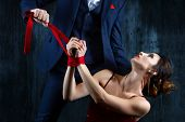 Couple In Dating. Rich Man Male Dress Skirt Tying Woman Hands. Woman Female In Expensive Red Evening poster