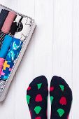Box With Different Colorful Socks. Feet Selfie And A Socks Organizer On A White Background. Top View poster