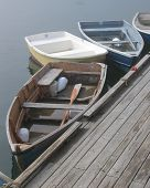 picture of dory  - dories tied to a dock by the sea.