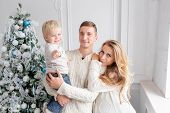 Happy Family Portrait In Home - Father, Pregnant Mother And Their Little Son. Happy New Year. Decora poster