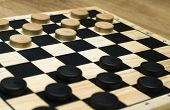 stock photo of draught-board  - Draughts board with black and white peices set out at the start of a game