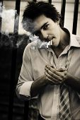 Depressed Business Man Smoking 3 Cigarettes