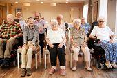 Group Of Seniors Enjoying Fitness Class In Retirement Home poster