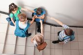 Little children bullying their classmate indoors poster