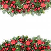 Christmas Festive background border with red bauble decorations, winter flora of holly berries, snow poster