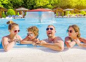 Happy Family In The Pool, Having Fun In The Water, Dad With Three Kids Enjoying Aqua Park, Beach Res poster
