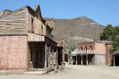 stock photo of wild west  - Scenery in an Old abandoned american western town - JPG