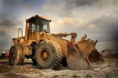 pic of heavy equipment  - Construction equipment with sky back ground on a new housing site - JPG