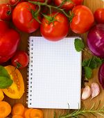stock photo of recipe card  - blank notebook for recipes with colorful vegetables - JPG