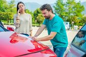Woman And Man Friendly Reporting The Damage Of The Car After Accident poster