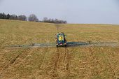 Tractor spraying pn field