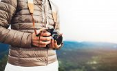 Photographer Traveler On Green Mountain, Tourist Holding In Hands Digital Photo Camera Closeup, Hike poster