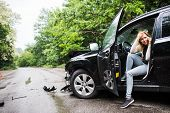Young Woman In The Damaged Car After A Car Accident, Making A Phone Call. poster