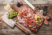 Sliced Jamon On Cutting Board With Figs, Grapes And Red Wine. Parma Ham, Hamon On Wooden Background  poster