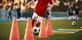 Soccer Drills: The Slalom Drill. Youth Soccer Practice Drills. Young Football Player Training On Pit poster