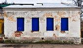 old abandoned wooden white with blue building