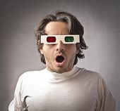 Astonished man wearing 3d glasses