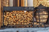 Firewood For The Winter. Firewood For Barbecue. A Background Made Of Wood. Cut And Chopped Logs With poster