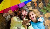 Hipster With Beard And Cheerful Girl Expect Rainy Weather Hold Colorful Umbrella. Romantic Couple Da poster