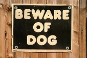 beware of dog sign on a fence