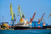 image of container ship  - View on trading port with the unloading container ship - JPG