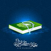 Arabic Islamic calligraphy of text Eid Mubarak with holy book Quran or Kuran Sharif on blue backgrou