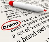 The word Brand defined in a dictionary with definition explained to emphasize awareness, branding, l