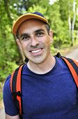 image of portrait middle-aged man  - Portrait of happy middle aged man on a forest trail - JPG