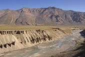 stock photo of manali-leh road  - River cutting through the arid mountains of the Himalaya on the high altitude road between Manali and Leh in Ladakh India - JPG