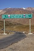 pic of manali-leh road  - Road sign in the arid mountains of the Himalaya on the high altitude road between Manali and Leh in Ladakh India - JPG