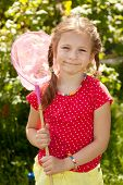 Smiling Girl With A Pink Butterfly Net