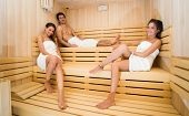 Group of people doing a sauna bath in a steam room