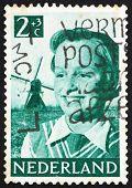 Postage stamp Netherlands 1951 Girl and Windmill