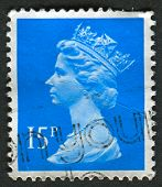 UK-CIRCA 1989: A stamp printed in UK shows image of Elizabeth II is the constitutional monarch of 16 sovereign states known as the Commonwealth realms, in Deep Bright Blue, circa 1989.
